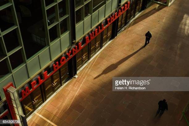People walk through the Denver Performing Arts Complex on February 8 2017 in Denver Colorado The complex features 10 performance spaces for plays...