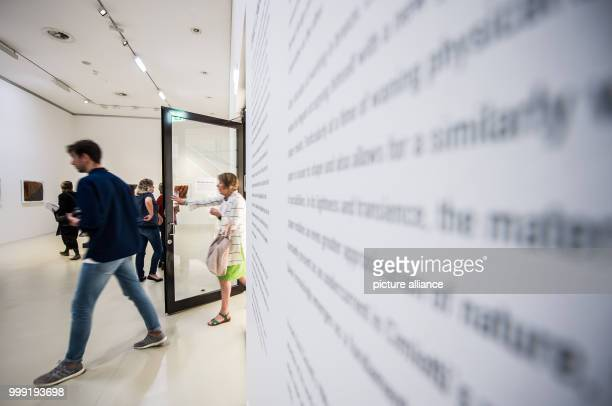 People walk through the 'Emil Cimiotti' exhibition during a press preview at the Sprengel Museum in Hanover Germany 17 August 2017 The exhibition is...