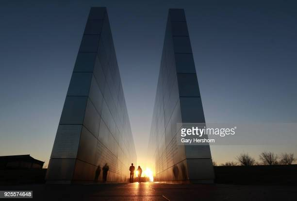 People walk through the Empty Sky 9/11 memorial in Liberty State Park on February 27 2018 in Jersey City New Jersey