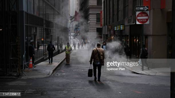 People walk through the financial district on April 08 2019 in New York City Markets are reacting as President Trump considers placing Herman Cain a...
