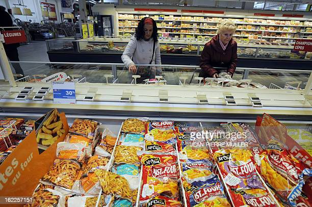People walk through the frozen products area of a supermarket in Bordeaux on February 21 2013 A Europewide food fraud scandal over horsemeat sold as...