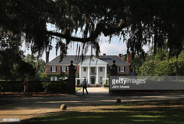 People walk through the grounds of the Boone Hill Plantation on July 16 2015 in Mount Pleasant South Carolina The plantation founded in 1681 is one...