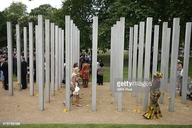 People walk through the July 7 memorial in Hyde Park during a service to commemorate the tenth anniversary of the London 7/7 bombings on July 7 2015...