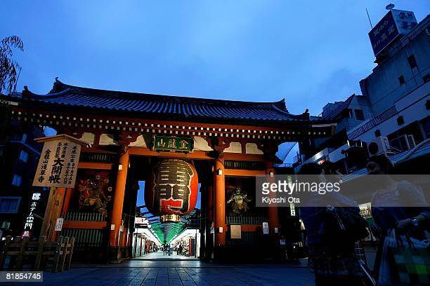 People walk through the Kaminarimon or Thunder Gate which is the entrance to the Nakamise shopping arcade leading to Sensoji Temple on July 8 2008 in...