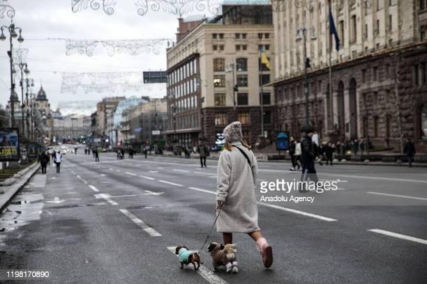 People walk through the Khreshchatyk Street, which is closed to traffic on weekends and public holidays, in Kiev, Ukraine on February 02, 2020.