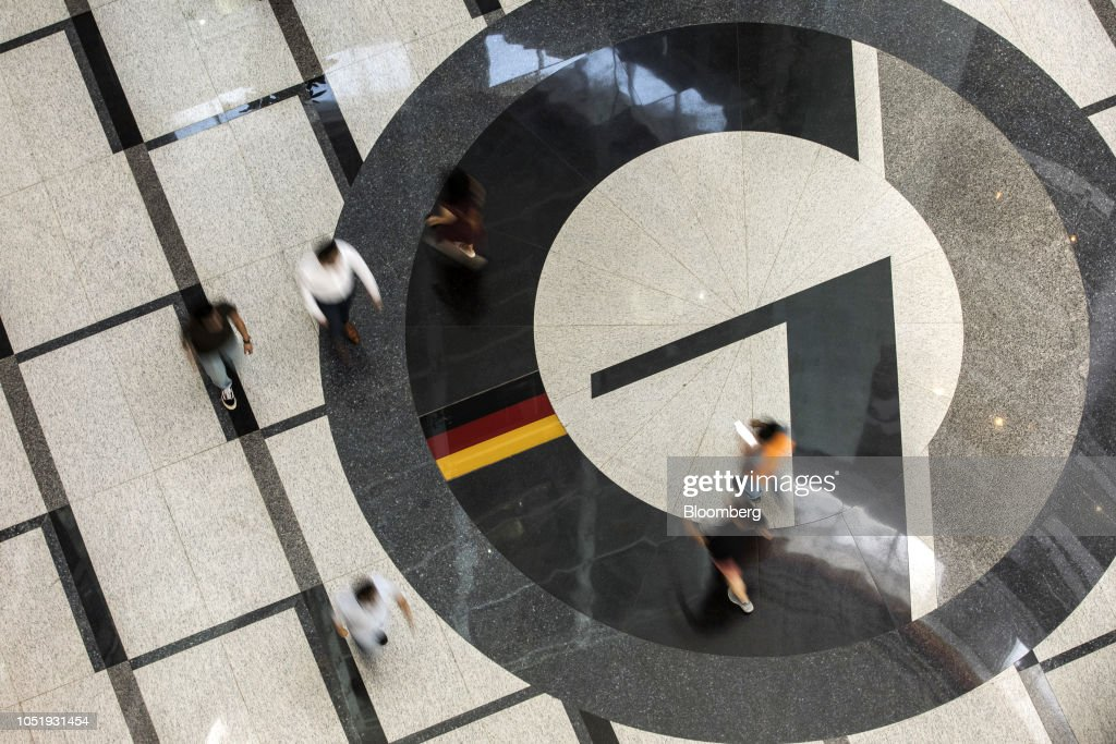People walk through the lobby of the German Center for