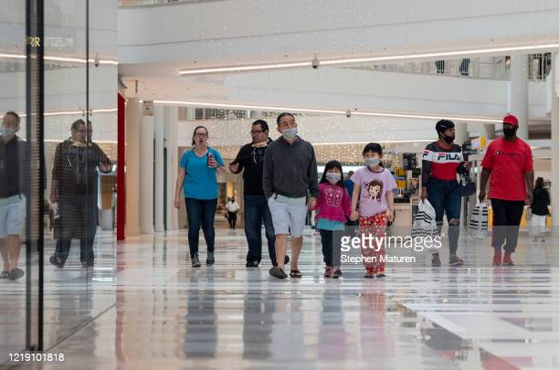 People walk through the Mall of America on June 10, 2020 in Minneapolis, Minnesota. Today marks the first day the destination mall has been open...