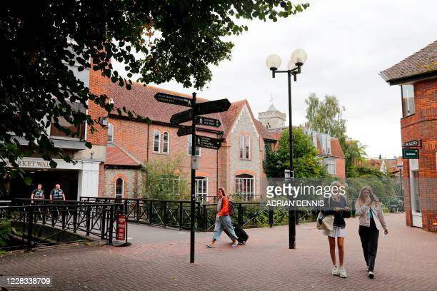 People walk through The Maltings shopping centre in Salisbury southern England on September 4 2020 which was the scene of the nerve agent attack on...