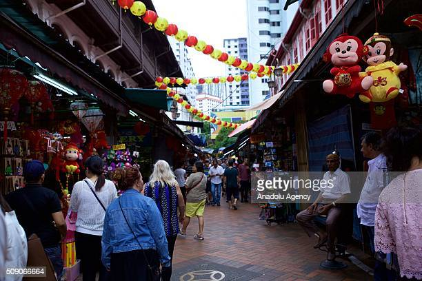 People walk through the market on the day of Chinese New Year Monkey at the Buddhist temple in Chinatown Singapore on February 8 2016