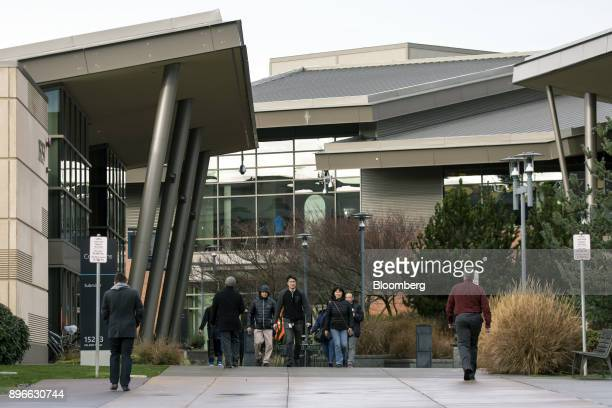 People walk through the Microsoft Corp main campus in Redmond Washington US on Tuesday Dec 19 2017 In the race to commercialize a new type of...