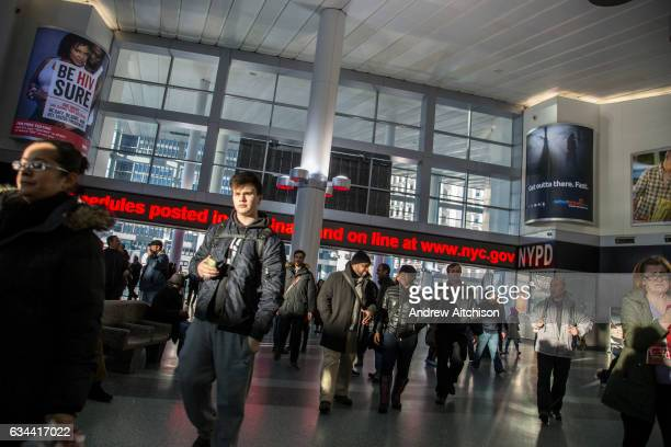 People walk through the new Staten Island Ferry Whitehall Terminal, in Lower Manhattan, New York City, New York, United States of America. The...