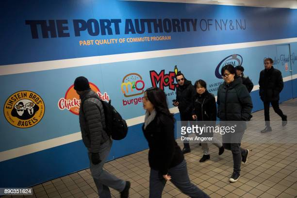 People walk through the New York Port Authority Bus Terminal after it reopened following an explosion December 11 2017 in New York City The Police...