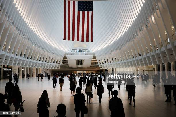 People walk through the Oculus located at the World Trade Center site during a morning commemoration ceremony for the victims of the terrorist...