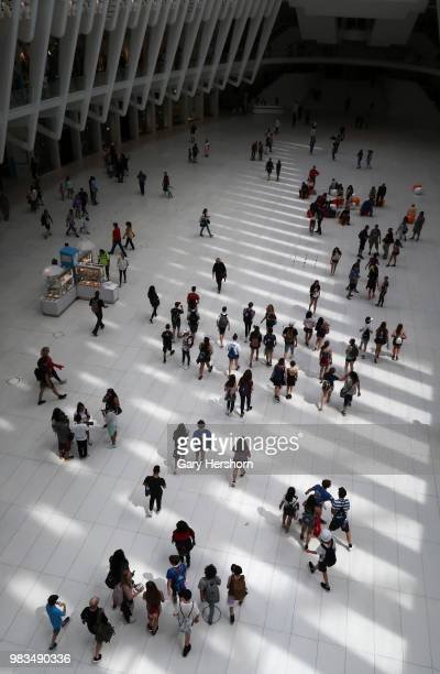 People walk through the Oculus transit hub at One World Trade Center on June 22 2018 in New York City