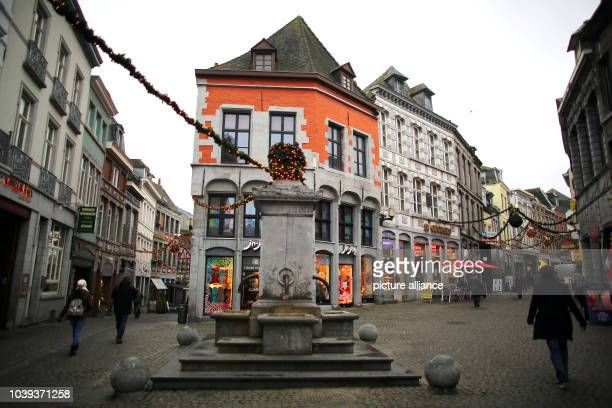 People walk through the pedestrian zone in the center of Mons Belgium 02 December 2014 The Belgian city in the region of Wallonia is the 2015...