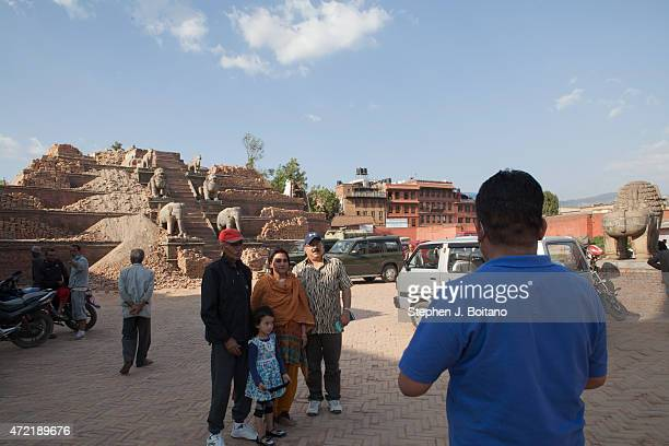 People walk through the ruins in Bhaktapur Durbar Square A major 79 earthquake hit Kathmandu midday on Saturday April 25th and was followed by...