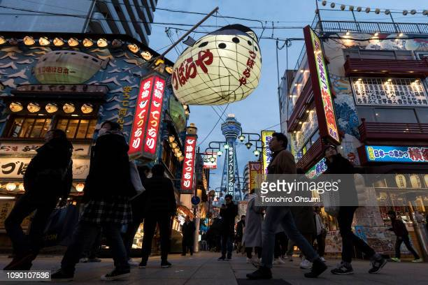 People walk through the Shinsekai area on January 04 2019 in Osaka Japan Osaka was selected on November 24 as the host city for the World Exposition...