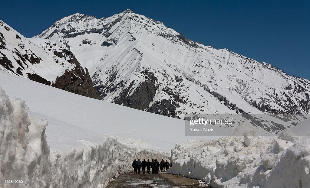 People walk through the snow-cleared Srinagar-Leh highway after it was reopen by authorities on April 06, 2013 in Zojila, 108 km (67 miles) east of Srinagar, the summer capital of Indian administered Kashmir, India. The 443 km (275 miles) long Srinagar-Leh highway was opened for vehicular traffic by Indian Border Roads Organisation after remaining snowbound at Zojila Pass for the past six months. The pass connects Kashmir with Ladakh region a famous tourist destination among foreign tourists for its monasteries, landscapes and mountains.