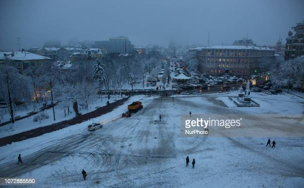 People walk through the square with the Saint Sophia's Cathedral seen downtown Kyiv Ukraine December 13 2018 Unity Council of Ukrainian Orthodox...