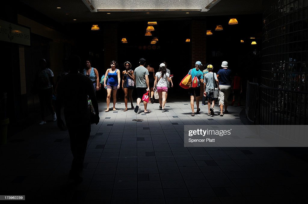 People walk through the Subway station at Coney Island on one of the hottest weeks in recent New York City history on July 18, 2013 in New York City. With daily temperatures in the high 90's and with the heat index making it feel in the triple digits, many New Yorkers are doing what they can to stay cool. A break from the heatwave is not expected until Saturday evening at the earliest.