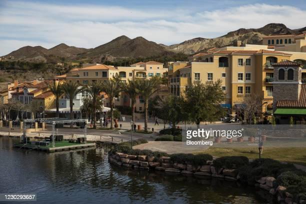 People walk through The Village at the Lake Las Vegas residential resort community in Henderson, Nevada, U.S., on Monday, Feb. 17, 2020. Nevada is...