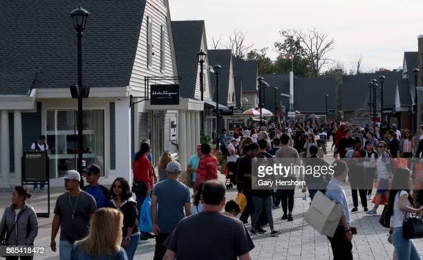 People walk through the Woodbury Common Premium Outlets Mall on October 21 2017 in Central Valley NY