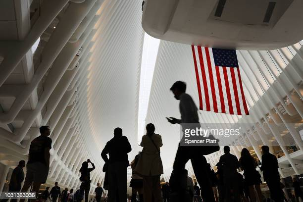 People walk through the World Trade Center Oculus as the retractable skylight is opened during a morning commemoration ceremony for the victims of...