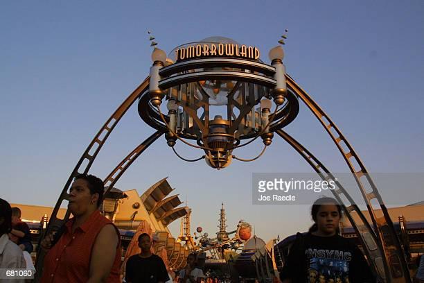 People walk through Tomorrowland in Walt Disney World's Magic Kingdom November 11, 2001 in Orlando, Florida.
