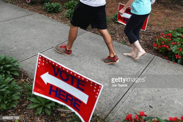 People walk to a polling place as ballots are cast during a special election in Georgia's 6th Congressional District at North Fulton Government...