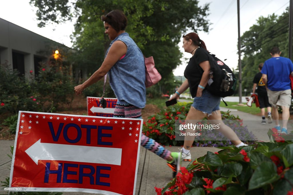 People walk to a polling place as ballots are cast during a special election in Georgia's 6th Congressional District at North Fulton Government Service Center on June 20, 2017 in Sandy Springs, Georgia. Democrat Jon Ossoff and Republican Karen Handel are vying to replace Tom Price, who is now the Secretary of Health and Human Services. The election will fill a congressional seat that has been held by a Republican since the 1970s.
