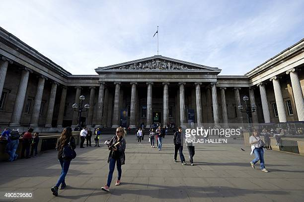 People walk to and from the main entrance of the British Museum in central London on September 29 2015 Hartwig Fischer who has become the first...