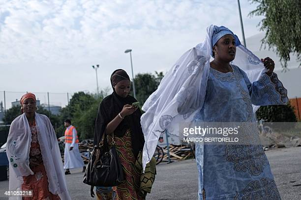 People walk to attend a celebration of Eid alFitr marking the end of the fasting month of Ramadan in Saluzzo near Turin on July 17 2015 Muslims...