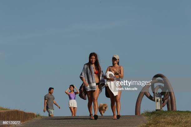 People walk to Coogee Beach on December 14 2017 in Sydney Australia The bureau of meteorology has forecast temperatures over 40 degrees for parts of...