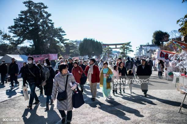 People walk to pray for the new year at Tsurugaoka Hachimangu Shinto shrine on January 1 2018 in Kamakura Japan 'Hatsumode' is the first Shinto...