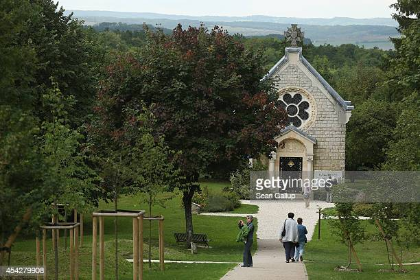 People walk to the commemorative chapel on the site of the former village of Fleury on August 27 2014 near Verdun France Fleury like a host of other...