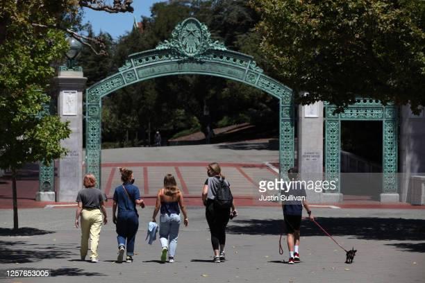 People walk towards Sather Gate on the U.C. Berkeley campus on July 22, 2020 in Berkeley, California. U.C. Berkeley announced plans on Tuesday to...