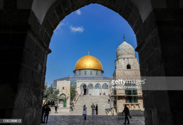 People walk towards the Dome of the Rock at the Aqsa Mosque compound, Islam's third holiest site, in the old city of Jerusalem on April 12 on the eve...