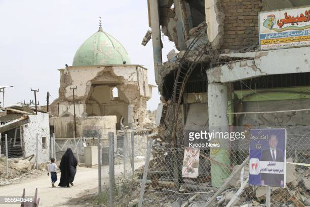 People walk towards the ruined Great Mosque of alNuri in Mosul's Old City in Iraq on May 6 2018 ==Kyodo
