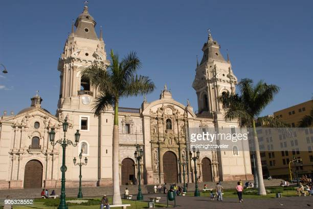 People walk town square Plaza de Armas and Cathedral of Lima Peru