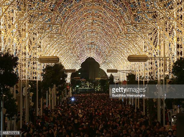 People walk under illuminated shopping street as a part of the 19th Kobe Luminarie on December 5 2013 in Kobe Japan The annual illumination event...