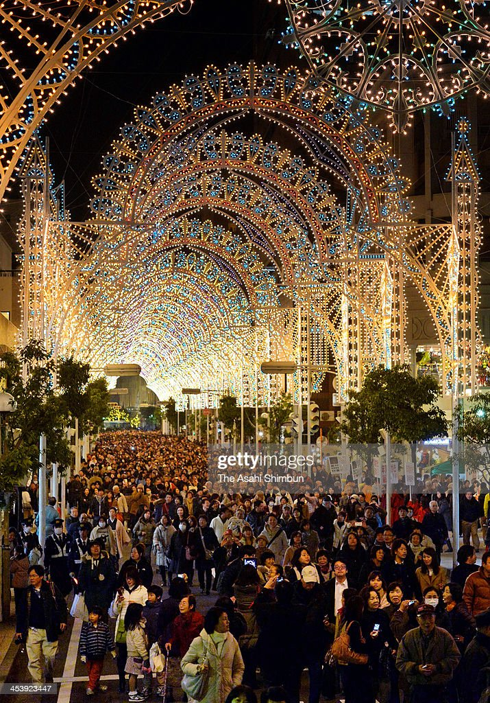 People walk under illuminated shopping street as a part of the 19th Kobe Luminarie on December 5, 2013 in Kobe, Japan. The annual illumination event, which began in 1995 to commemorate the victims of Hanshin Awaji Great Earthquake, will be taken place from December 5 to 17 this year.