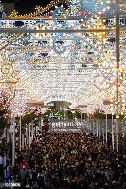 People walk under illuminated shopping street as a part of the 20th Kobe Luminarie on December 4 2014 in Kobe Hyogo Japan The annual illumination...