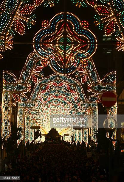 People walk under the illuminated street during the Kobe Luminarie annual event on December 1 2011 in Kobe Japan The Luminarie festival is held in...