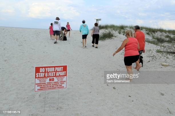 People walk up a public access to the beach on April 19 2020 in Jacksonville Beach Florida Jacksonville Mayor Lenny Curry announced Thursday that...