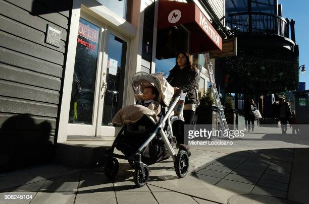 People walk up and down Main Street as Park City prepares for the 2018 Sundance Film Festival on January 17 2018 in Park City Utah
