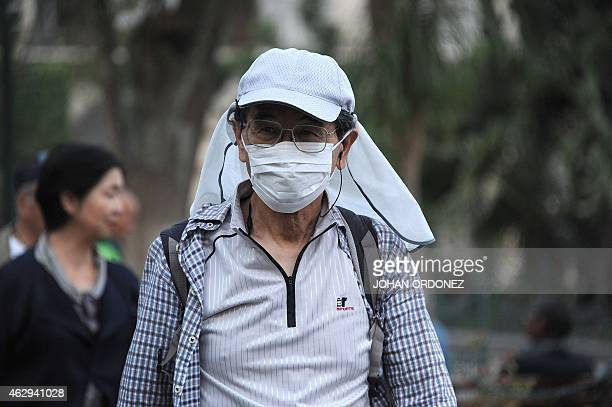 People walk with face masks due to ashes from the Fuego volcano in Antigua Guatemala Sacatepequez departamento 45 km southwest of Guatemala City on...