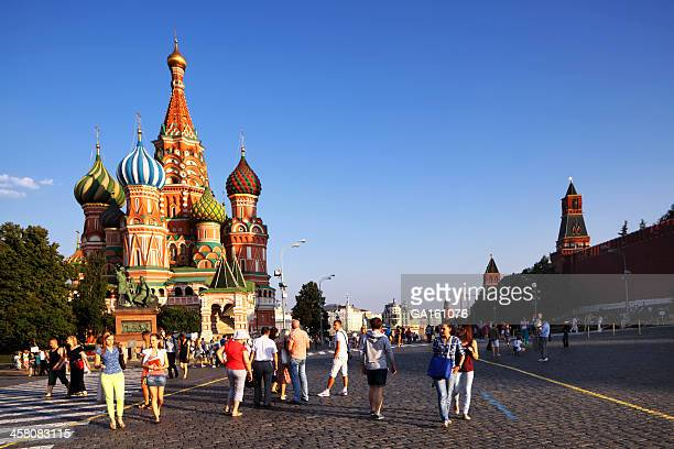 People walking about in Red Square at sunset