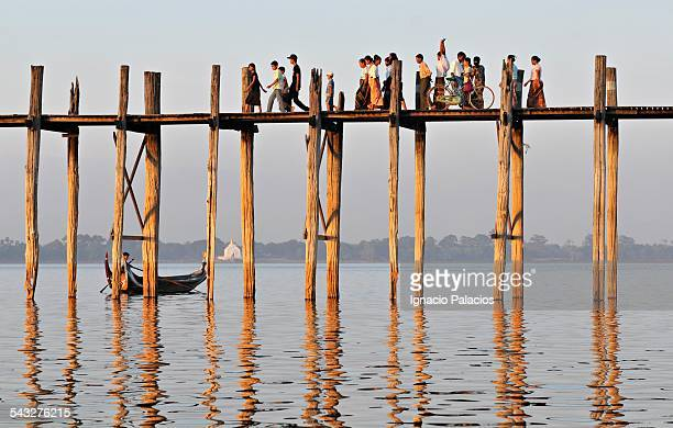 People walking across Amarapura bridge