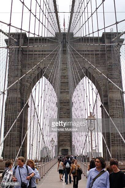 CONTENT] People walking across the Brooklyn Bridge New York City