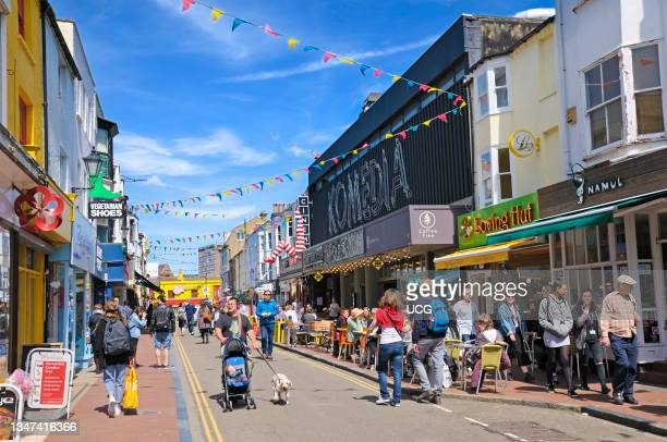 People walking along a sunny Gardner Street in the trendy North Laines district of Brighton..